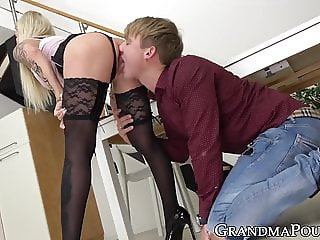 Inked mature hottie bouncing on fat younger cock