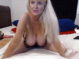 awesome blonde gilf with huge oiled boobs