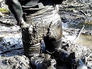 The sexy woman in leather trousers and high boots in mud!!!