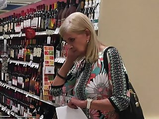 Upskirt of mature blonde at grocery