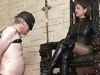MISTRESS LEATHER CLAD AND HER BOOT WORSHIPER