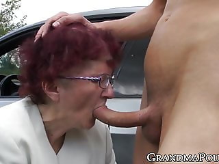 Redhead grandma sucks off young stud at secret outdoor place