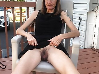 Skinny granny with hairy pussy lifting her dress