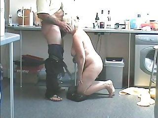 Granny Strips Naked and Sucks Cock in the Kitchen