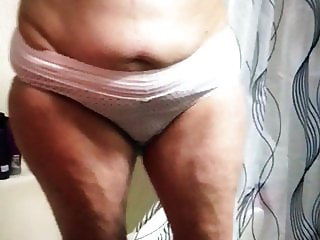 Sexy granny Rose putting on bra and panty