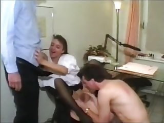 Office brunette in black stockings enticed by colleagues