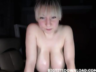 Blonde with gigantic tits posing to the webcam
