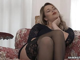 Solo, voluptuous blonde, Nikky Dream is gently masturbating,